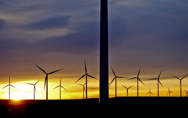 The sun sets behind several wind turbines at Wild Horse Wind and Solar Facility.