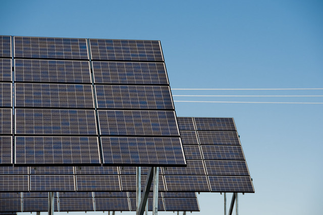 Large solar arrays in front of a blue sky at Wild Horse Wind and Solar Facility.